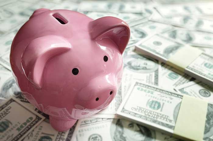 piggybank hundred dollar bills