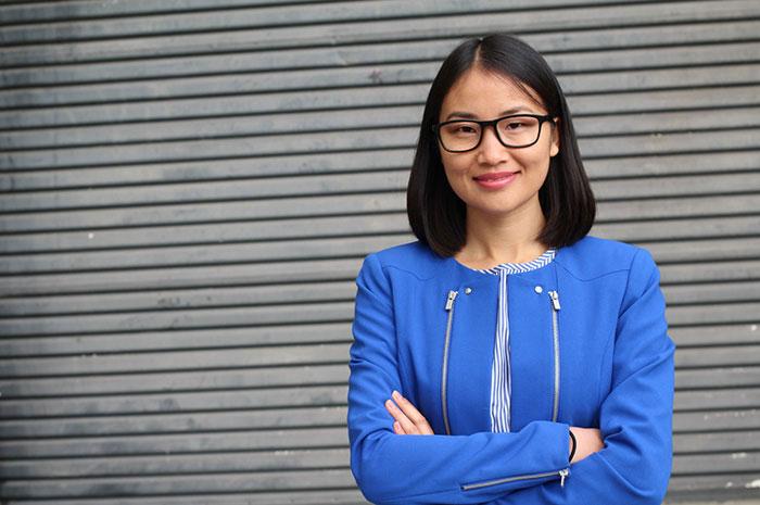 successful businesswoman in blue