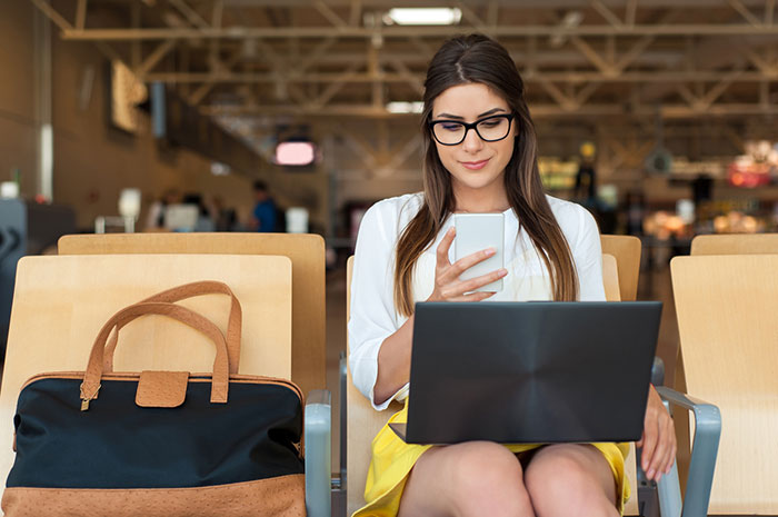 woman laptop airport